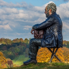 32-Seated-Figure-looking-over-Yorkshire-Sculpture-Park