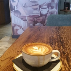 Coffee Served with a Smile by Neil Scarlett